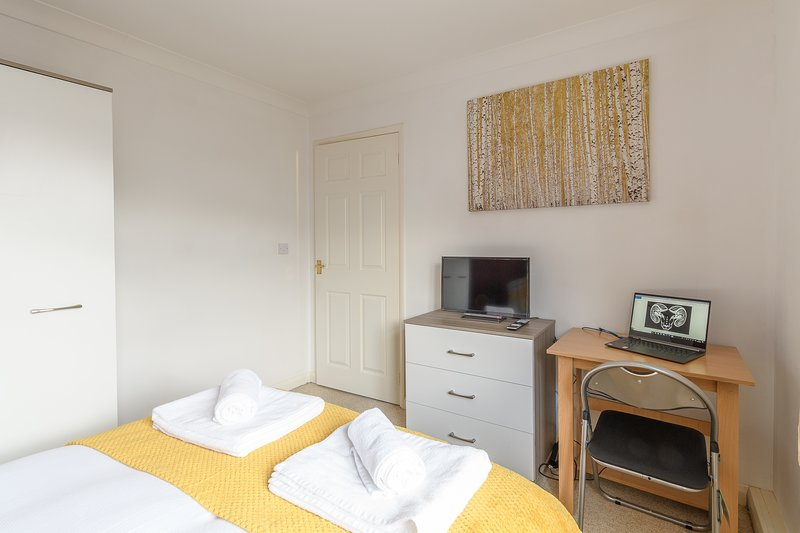 Double bedroom with Smart TV and workstation