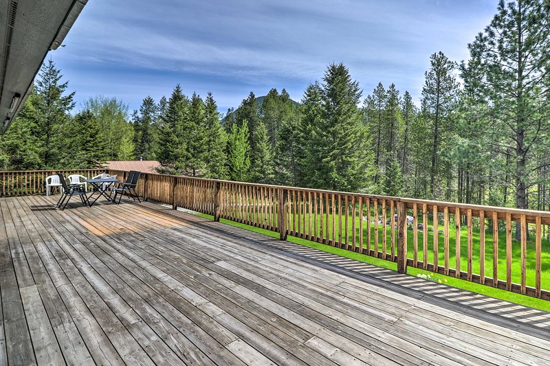 Spend summer evenings on this vacation rental's massive deck.