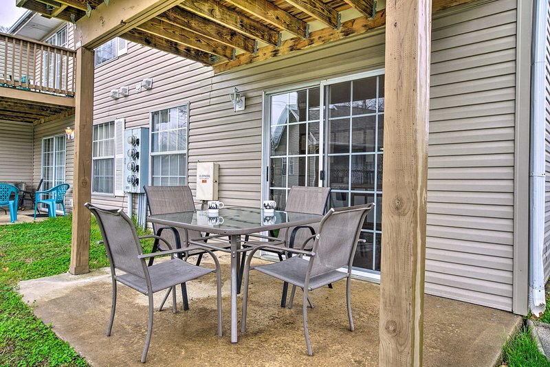 The vacation rental features a furnished patio, the perfect place to sip coffee.