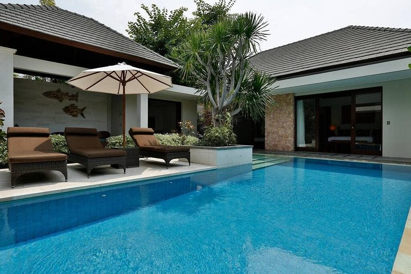BEACHFRONT 3 BEDROOM FAMILY VILLA  Villa 9 is a three bedroom villa which sleeps 6 people. Two king size bedrooms and a smaller room with 2 singles in it. This villa boasts a gorgeous tropical garden, a private infinity pool, quality fixtures and fi...
