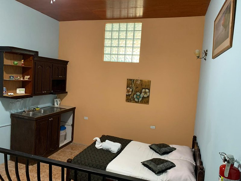 See Belize COZY Vacation Studio w/ SWIMMING POOL, OVERWATER DECK & ROOF TERRACE, holiday rental in Belize City