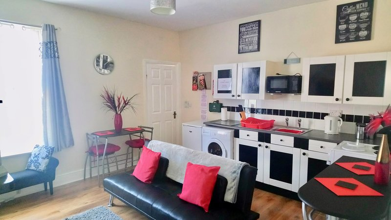 Kitchenette/Kitchen with a dining table for x2 and a sofa-bed sleeps x1 adult or x2 small children.