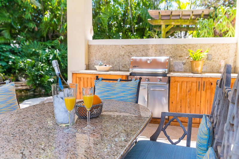 Covered dining, gas grill and refrigerator
