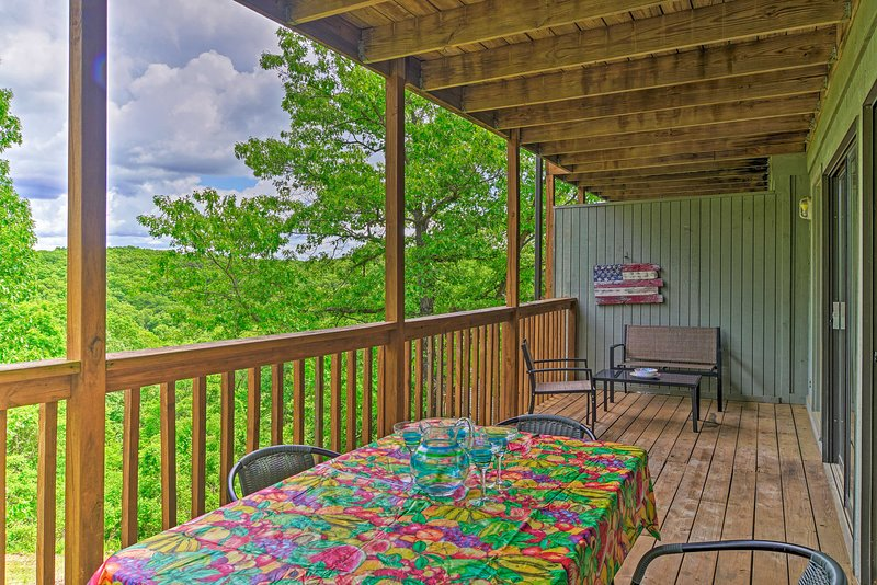 Breathe in the crisp forest air from this vacation rental's covered deck.