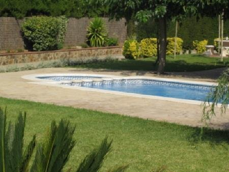 Sunny pool and large private garden