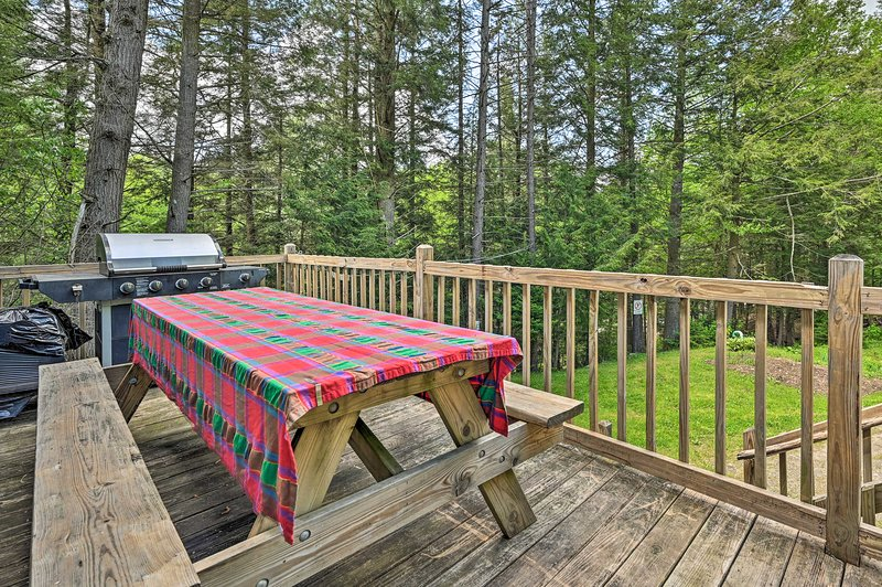 Host an evening cookout on this vacation rental's deck.