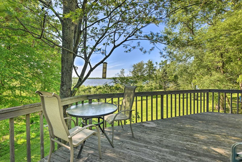This home has a peaceful deck that's perfect for morning coffee!