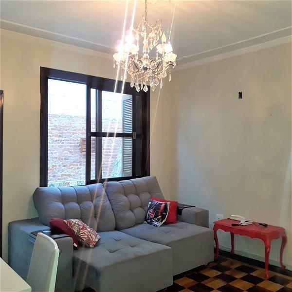 Excelente apto térreo de 2 dormitórios, holiday rental in Viamao