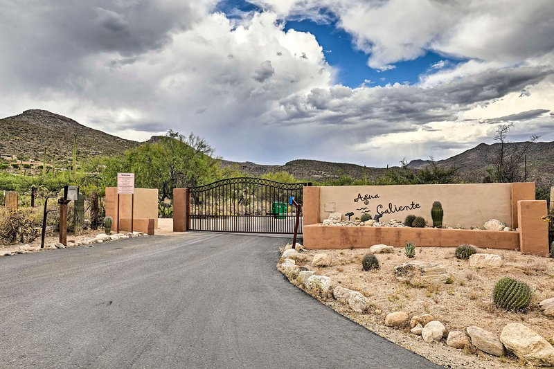 A gated community nestled against the Santa Catalina Mountains.