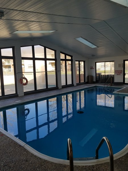 Nice Indoor Pool looking out at Outdoor Pool. Hot Tub, Sauna and Fitness Room at Clubhouse.