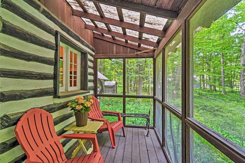 Enjoy your morning coffee from this screened porch.