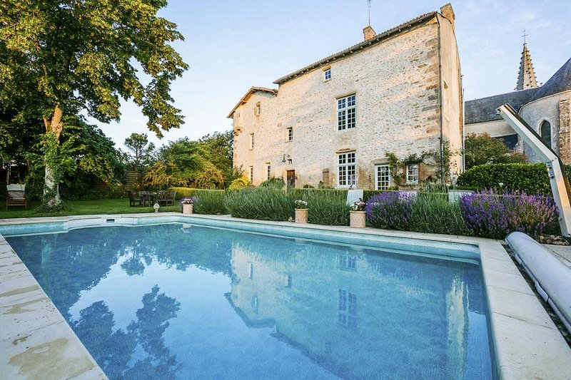 Medieval Priory and Tower with pool (Sleeps 22), vacation rental in Saint-Jean-de-Sauves