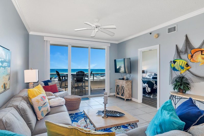 Living Room with access to Private Balcony overlooking the Gulf and Queen Size Sleeper Sofa
