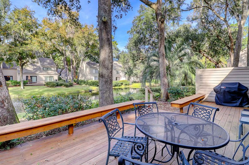 Lovely outdoor deck has tranquil view of lagoon, outdoor dining table and 3 burner gas grill for enjoying the beautiful outdoors from the comfort of your villa.