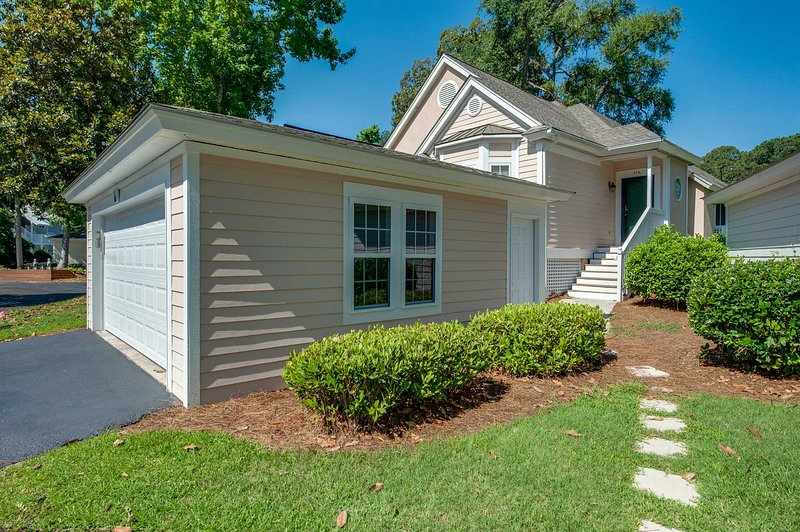 Lovely exterior with garage and paver path