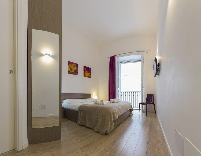 Camera da letto con bagno  privato e balcone