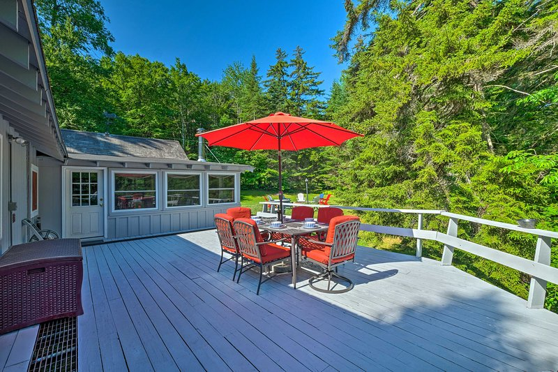 The cozy home has 3 bedrooms, 2 bathrooms and a spacious deck for relaxing.