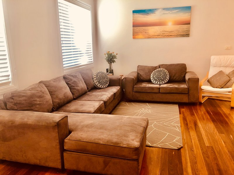 The main lounge room has a large smart TV with Netflix and a huge array of books, DVD's, CD's.