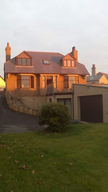 Our home. The flat has it's own entrance through the double doors off the driveway