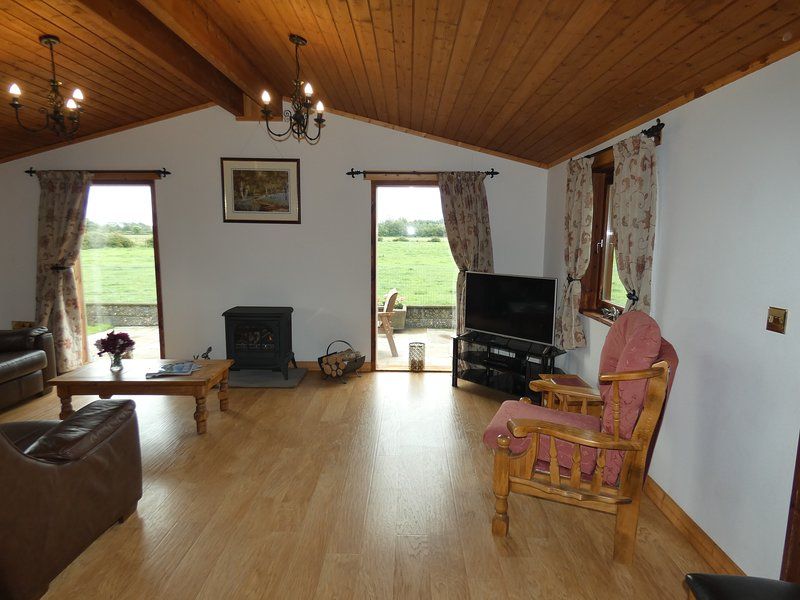 Spacious living area. Lovely and warm with underfloor heating and gas log effect stove.