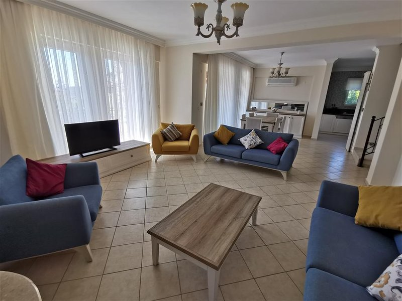 Spacious lounge with TV and satelite system. Wifi, Through to dining area, kitchen and large terrace