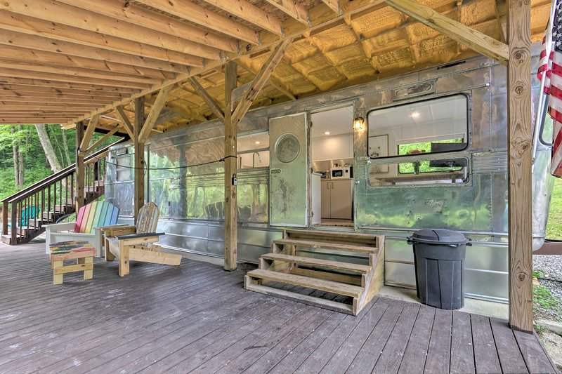 A converted 1950s trailer, the property boasts rustic charm with modern comfort.