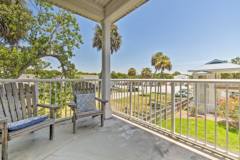 With a furnished balcony, this home offers views of soaring palm trees.