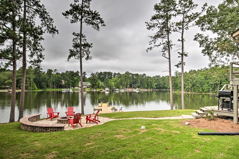The renovated property features a fantastic outdoor space with deck & fire pit.