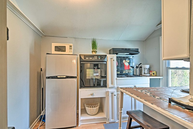 The hideaway features a well-equipped kitchen filled with charm.