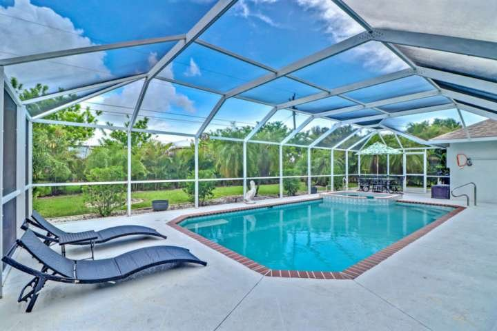 Enjoy your own private oasis in this beautiful Cape Coral home, complete with an outdoor living space you'll love!