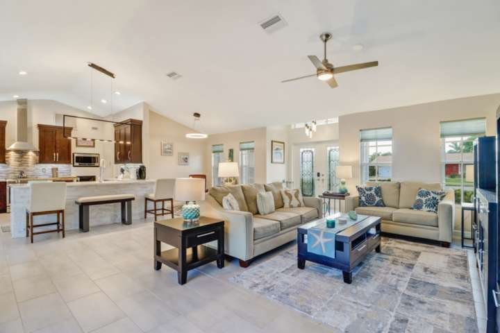 The stunning open concept great room - fully tiled, vaulted ceilings, impeccably decorated - the perfect getaway.