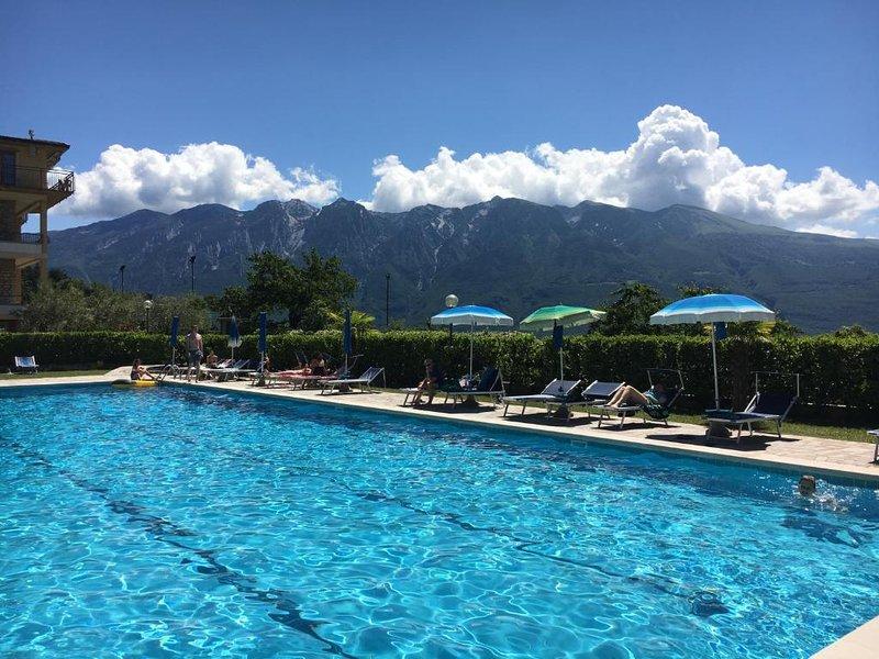Ferienwohnung mit Seeblick und Pool, Ferienwohnung in Gardola