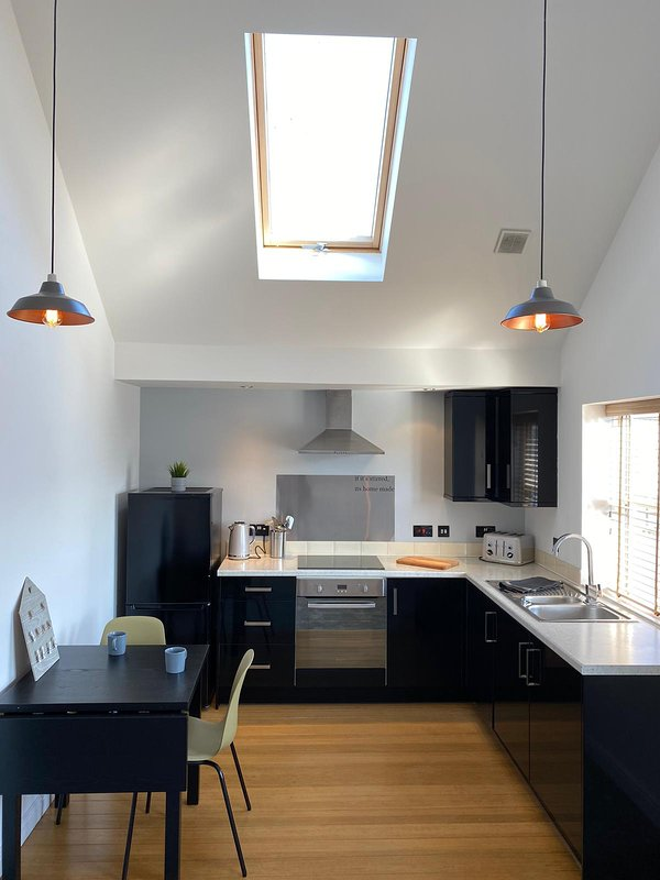 Fully equipped modern kitchen with dining facilities