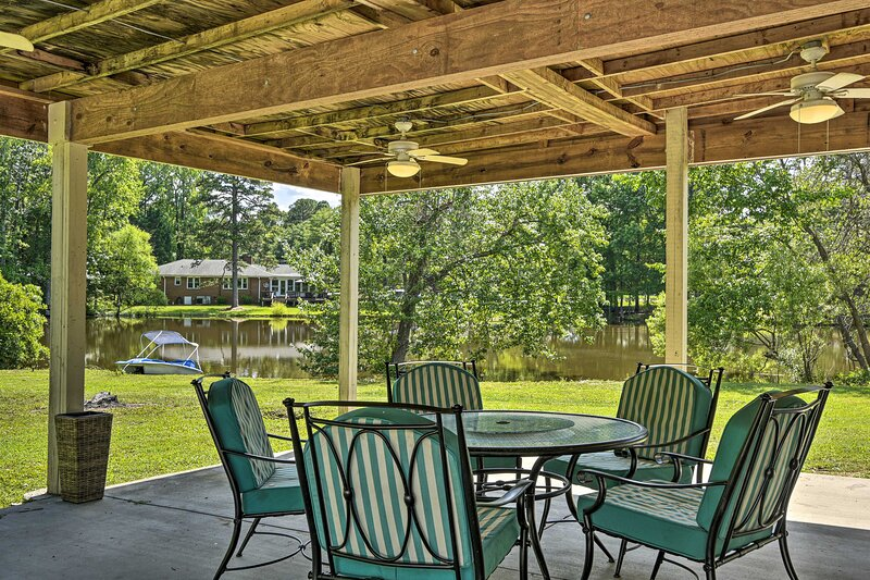The 3-bedroom, 2-bathroom getaway is set on a private pond.