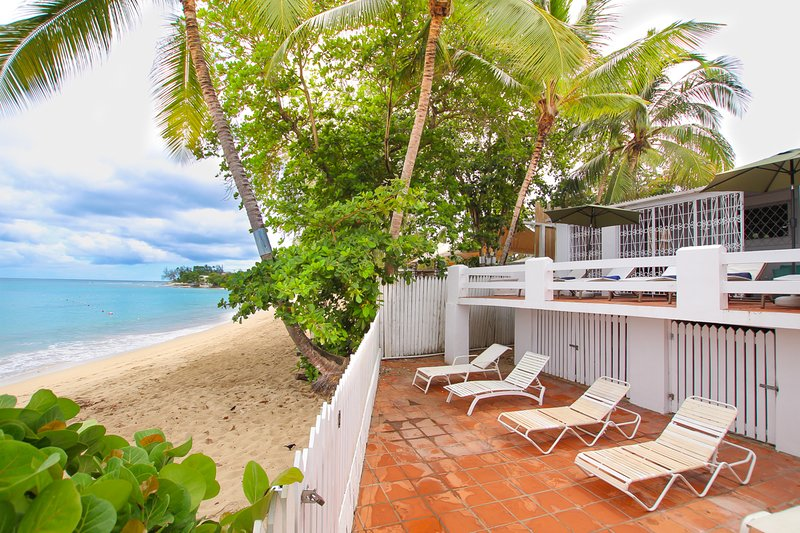 Welcome to High Tide! A beachfront home on a beautiful sandy beach with turquoise water perfect for swimming and snorkeling