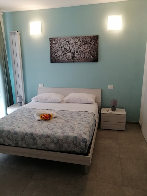 Camera matrimoniale smeraldo, holiday rental in Mezzana-Colignola