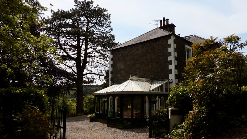 The approach to Beechwood House with ample private parking.