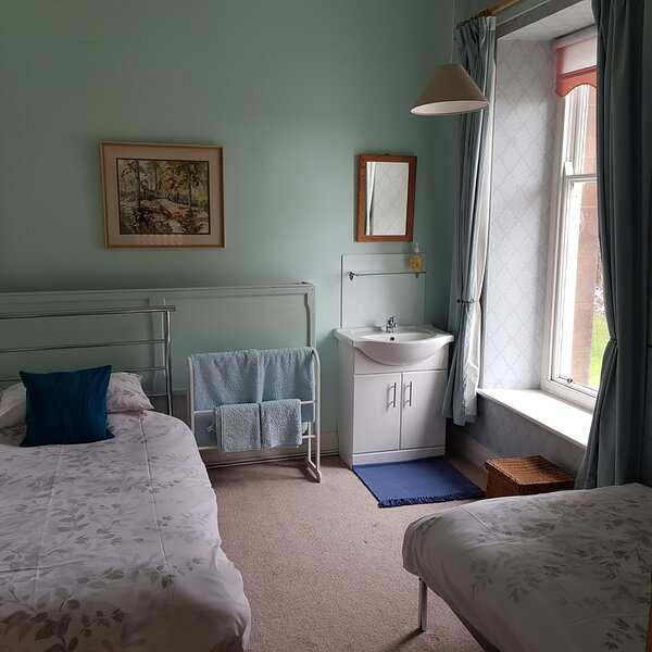The Blue bedroom which has 2 single beds