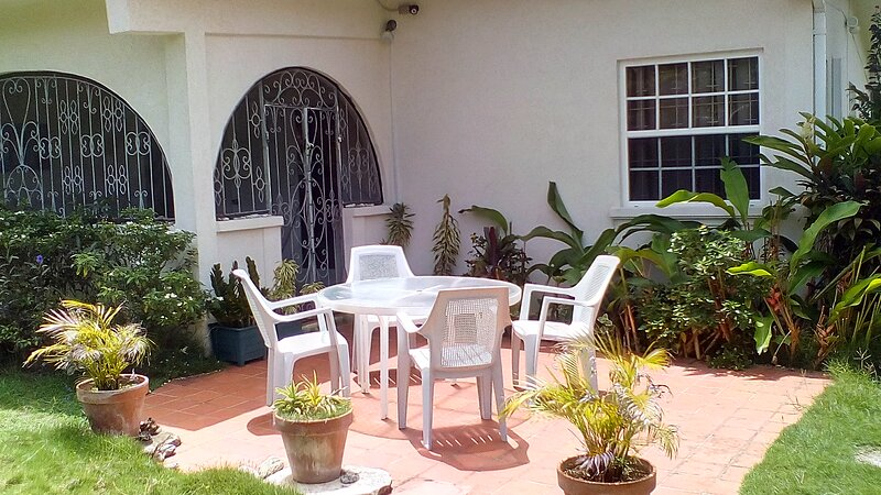 Patio #2 is an outdoor patio, which overlooks the front lawn and beautiful garden.
