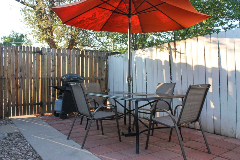 Enjoy grilling on the patio behind this vacation rental cottage.