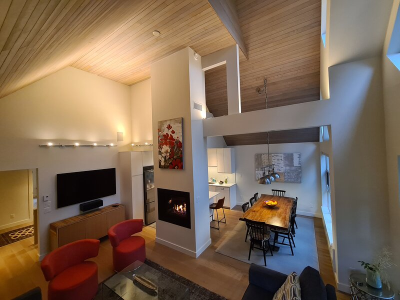 The living room, dining area and kitchen are in a bright open plan.