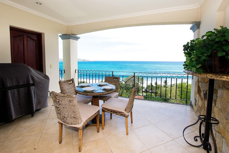Private balcony with dining table and stunning ocean view