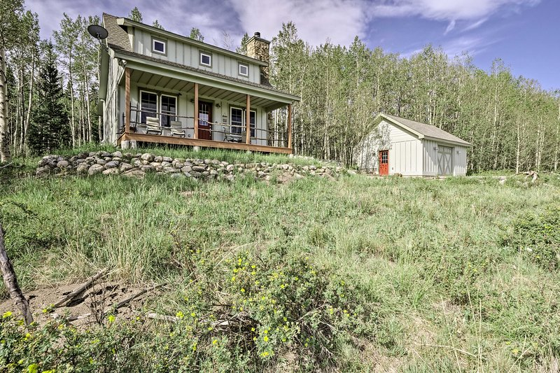 The 3-bedroom, 3-bathroom cabin sits on 2 acres bordering a national forest.