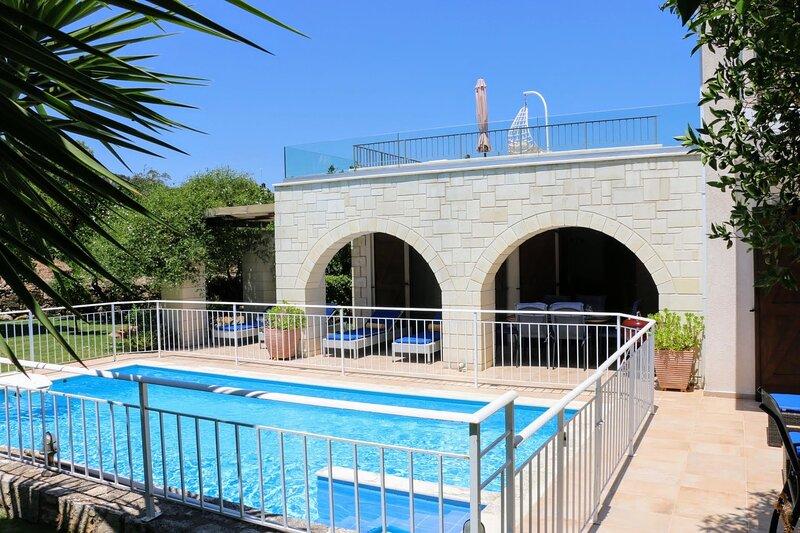 Across the pool towards the verandah and roof terrace