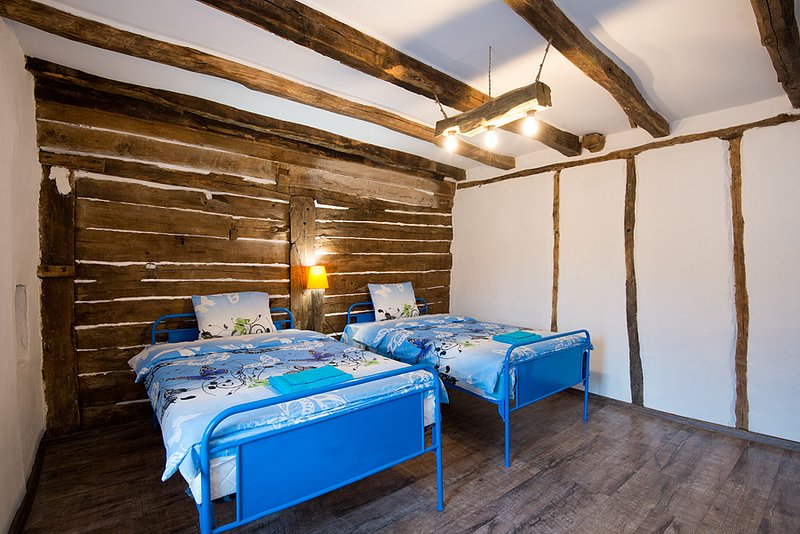 The Old Nest house, room with wooden wall, holiday rental in Haskovo Province