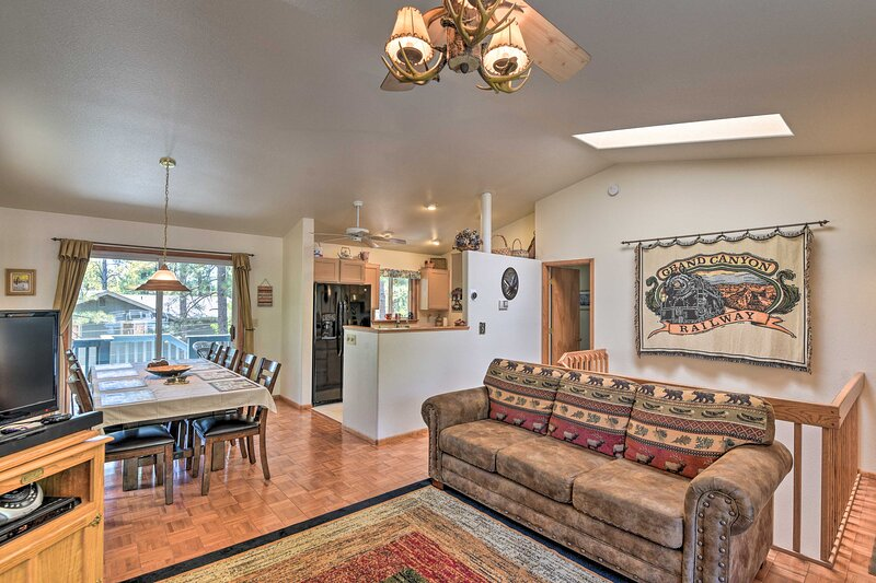 Step into the spacious living area with a flat-screen TV and fireplace.