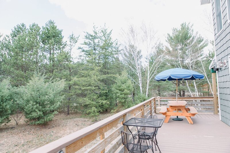 Looking out from the hot tub to the wrap around deck there's plenty of seating for guests to enjoy dinner outside.