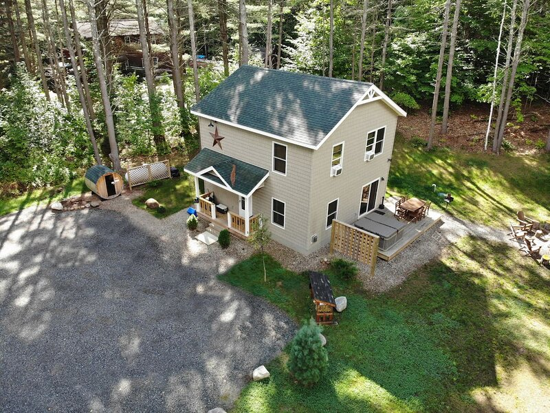 Cascade Mountain Chalet nestled in the woods, spacious parking, expansive deck, welcoming you to the serenity of the Adirondacks!