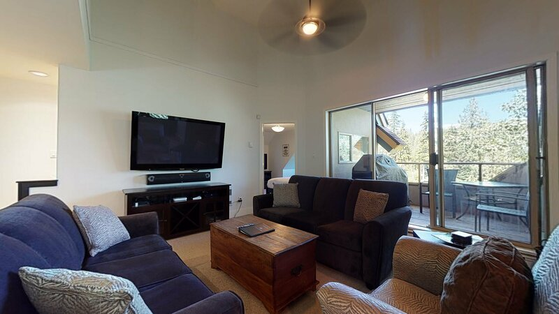 Living area w/ sofa bed and cable TV
