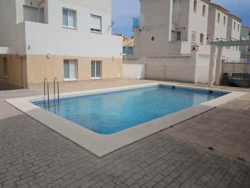 Ricky´s Village Oliva Sunset: Duplex con piscina junto a la playa., holiday rental in Oliva